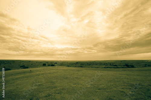 Wide Texas landscape and cloudy sky old-fashioned split toned effect Poster