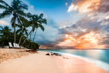Fototapety Exotic long exposure seascape with palm trees at sunset, on a public beach in Cayo Levantado, Dominican Republic