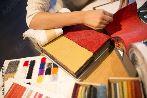Women looking to take a sample fabric to hand