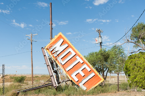 Poster Fallen and rejected old motel sign from now deserted building along Route 66