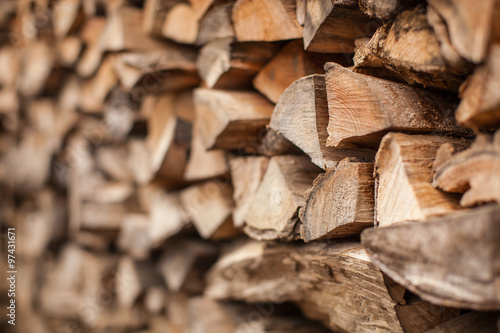 Tuinposter Brandhout textuur background of Heap firewood stack, natural wood