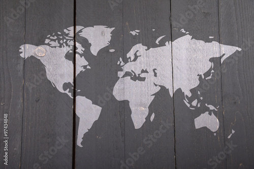 World map on dark black wooden background