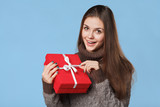 Happy smiling girl in excitement with Christmas box. Christmas Gift
