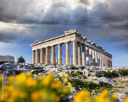Fototapeta Parthenon temple with spring flowers on the Acropolis in Athens, Greece