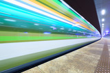 Fototapety Train in motion at the station