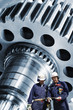 industry workers with cogwheels and gears machinery