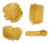 Fototapety Gold paint stokes isolated on white background
