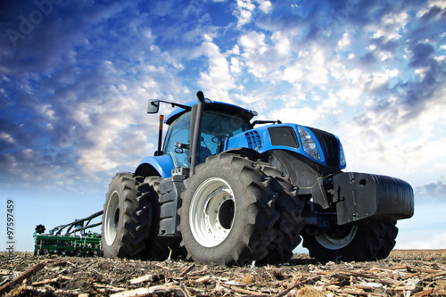 Juliste Blue tractor working on the farm