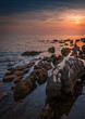 Sunset Over the Sea with Rocks in Foreground.