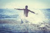 Man running splashing ocean sea water. Fun - Fine Art prints