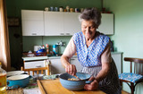 Fototapety Senior woman baking
