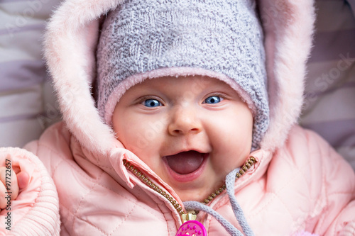 894933480 Portrait of baby girl in winter jacket and hat