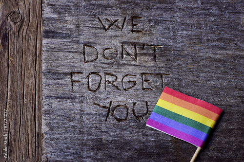 Poster text we do not forget you and a rainbow flag