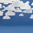 Abstract background composed of white paper clouds over blue.