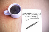 Coffee on the table with note writing government contract - 97748649
