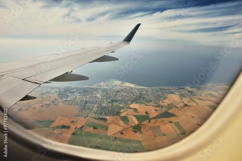 Fototapeta Looking through window aircraft, landing to Copenhagen airport Kastrup.