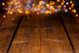 Fototapety Wood background with colorful blurry lights