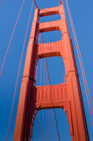 View of the south tower of the Golden Gate Bridge from the walkway. The famous Art Deco landmark is painted orange to enhance its visibility in fog. - 97820847