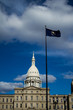 Michigan flag flying in front of the capital