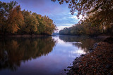 Peaceful and Serene River with Sky Reflections - 97847861