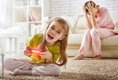 child playing video games Poster