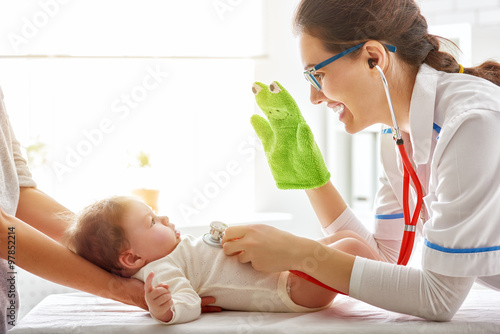 Poster doctor examining a baby