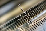 Knitting machine needle closeup