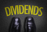 Top View of Business Shoes on the floor with the text: Dividends