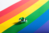 Fototapety two rings on background of rainbow flag