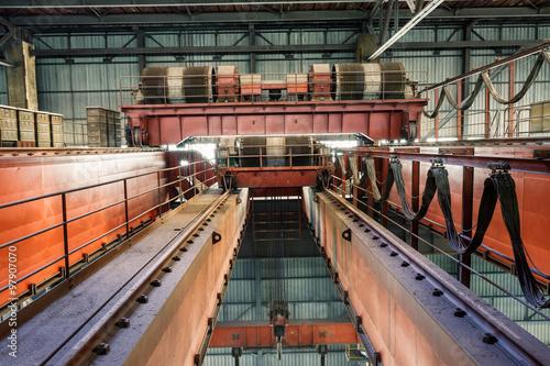 Foto op Canvas Kip Large industrial crane equipment scene in steel mill