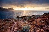 Sunset at coast near Galeria in Corsica, France