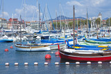 Fishing boats, super yachts in sea marina in Nice Port French Riviera on sunny summer day