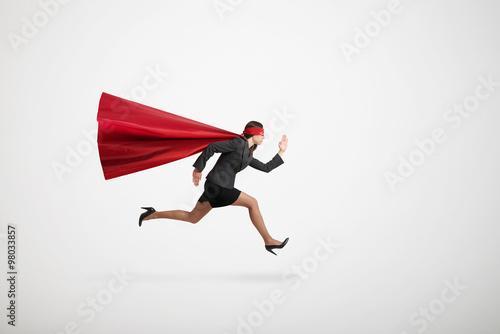 Poster businesswoman wearing like superhero very fast running