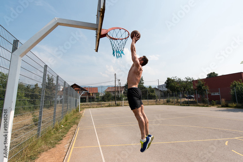 Fotografiet Basketball Player Is About To Slam Dunk