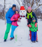Family with a snowman