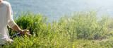 Fototapety Woman meditating at the sea