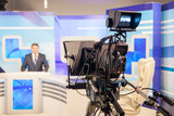 tv studio camera recording male reporter or anchorman. Live broadcasting