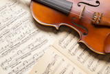 Vintage violin on the  sheet music.