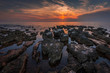Sunset Over the Sea with Rocks in Foreground