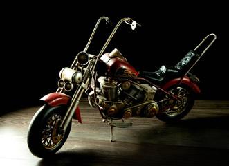 Toy motorbike isolated on black background © alexx_60