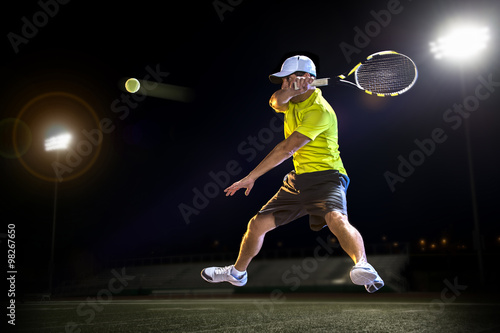 Fotobehang Tennis Tennis player during a match at night