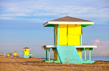 Hollywood Beach Florida, bright yellow lifeguard house at sunrise with ocean and beautiful sky in the background