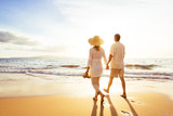 Mature Couple Walking on the Beach at Sunset - 98290626
