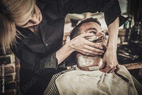 client during beard shaving in barber shop stock photo and royalt. Black Bedroom Furniture Sets. Home Design Ideas