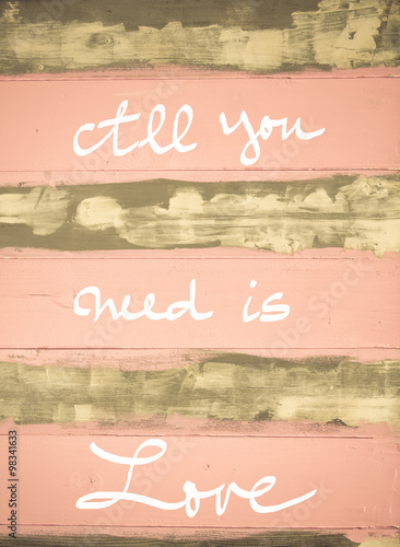Poster Concept image of All You need is love motivational quote hand written on vintage
