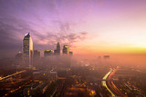 Fototapety A foggy and colorful sunrise in Charlotte, North Carolina during the morning rush hour traffic.