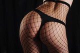 Perfect sexy bum in black fishnet tights