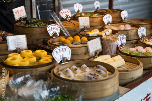 Poster Oriental Asian desserts sold at night street market in  China