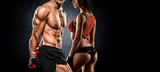 Fototapety athletic couple poses for the camera