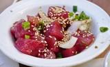 Hawaiian poke with onions and sesame seeds